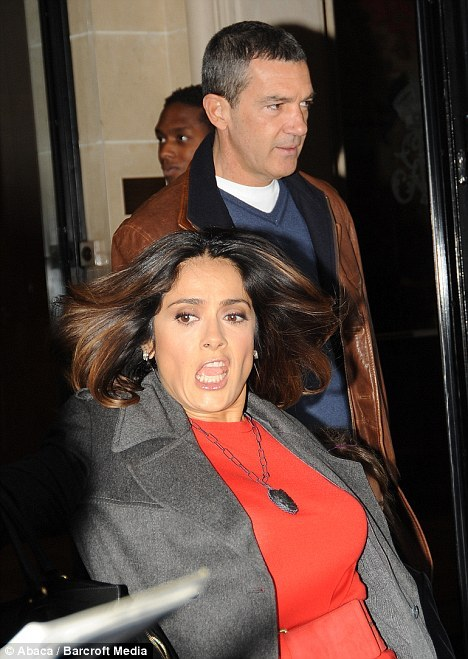 Here's a picture of Salma Hayek tripping As in tripping and falling, not tripping balls. Thank god for omnipresent paparazzi and their expensive cameras. Via