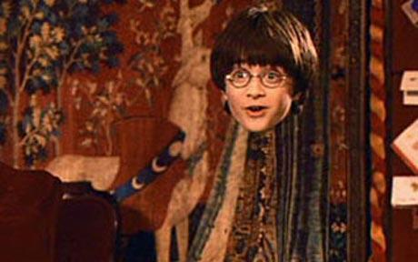 30 Day Harry Potter Challenge Day 27 - Would you rather own The Invisibility Cloak, The Resurrection Stone or The Elder Wand? The Invisibility Cloak.  I wouldn't want the Resurrection Stone because have any desire to bring back my loved ones from the dead and I believe that I will be reunited with them after I die, so I will get to see them again anyway, and I don't want to be all powerful, so no Elder Wand for me either.  I like warm blankets and stuff, and that's how I imagine the Cloak to be - like a really warm and soft blanket that also happens to let you be invisible.  I could just curl up and take a nap and no one would know I was there.  For some reason, that makes me happy.  :) And of course I could always use it to creep on people and play pranks, which might be fun… ;)