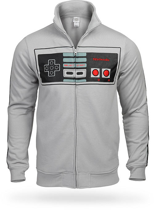 gamefreaksnz:   Nintendo Controller Track Jacket Retro Control Freak Officially-licensed Nintendo gear. Buttons not functional. Zipper is, though.  Subtle from the back; geeky from the front USD$39.99