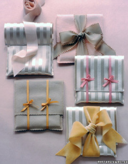 Personalize small gifts by slipping them into hand-stitched pouches.  Instructions for making fabric envelopes, Martha Stewart.