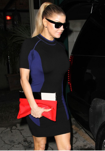 Fergie spotted out on the town carrying a Kate Spade New York clutch.