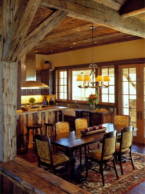 Rustic dining area with old, repurposed exposed wood beams, inside a Montana log home (via Montana mix - traditional - dining room - other metros - by Design Associates - Lynette Zambon, Carol Merica)