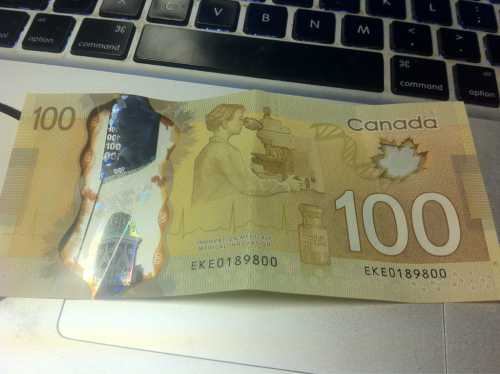 new canadian plastic $100 bills, the clear windows and colour holograms are pretty sweet <3