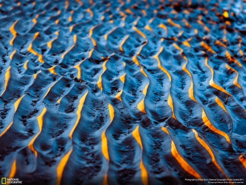 scienceisbeauty:  Suntipped Sand On a cool crisp sunset along the Dublin Shoreline, the low angle of the evening sun illuminated the tips of the sand patterns made by the waves. Photo Location: Dublin Coastline, Ireland Photo and caption by Ronan Bree Source, National Geographic Photo Contest 2011