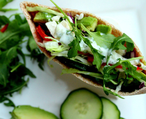 justwanttobehealthyandfit:  Feta avocado arugula tomato red cabbage capsicum pita covered with tzatziki.