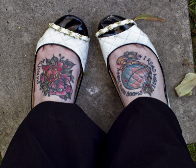 I got these in september. I'd wanted my feet done for ages, but pussed out for awhile since I HATE feet. Haha. The left foot is Harry Potter inspired, as i'm a mega geek, we decided to make the deathly hallows symbol ornate, so only fellow geeks would call it out for what it was but no one else would instantly know. The rose was added because my artist does amazing roses & I wanted a rose off her for sure. The word 'always' is another Harry Potter reference.  The Right foot is a globe (obviously!) and the quote 'I read more maps than books' Lyrics from Brand New. I grew up fascinated by globes, maps and even reading street directories. I've always wanted to explore. As soon as I hear the lyrics, I knew they'd be perfect to add to the piece.  These were done in the one sitting, about 2hrs by the gorgeous & so talented Pip, At True Love Tattoo, in Sherwood, Brisbane. http://www.truelovetattoo.com.au Bridie. x