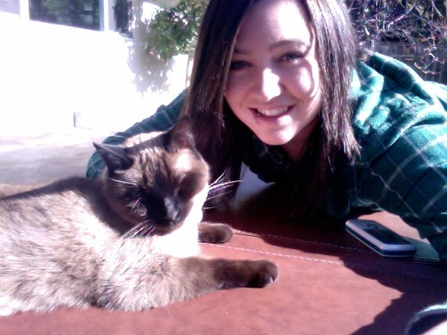 wyldanniemal:  Old pic of my kitty and I ^._.^ MEOW!