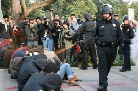 ladyofinsanity:  occupyallstreets:  UC Davis Pepper Spray Officer Also a Racist HomophobePike, one of the officers who sprayed the students, is a retired Marine sergeant who has been honored for his police work on campus, but he also figured in a discrimination lawsuit against the university. He has twice been honored by the university for exceptional police work, including a 2006 incident in which he tackled a scissor-wielding hospital patient who was threatening fellow officers. Afterward, he said he decided against using pepper spray because it might harm his colleagues or other hospital patients. (funny huh?) But an alleged anti-gay slur by Pike also figured in a racial and sexual discrimination lawsuit a former police officer filed against the department, which ended in a $240,000 settlement in 2008. Officer Calvin Chang's 2003 discrimination complaint against the university's police chief and the UC Board of Regents alleged he was systematically marginalized as the result of anti-gay and racist attitudes on the force, and he specifically claimed Pike described him using a profane anti-gay epithet. Tuesday, state lawmakers announced they would hold a hearing on the pepper-spraying incident. Assembly Speaker John Perez sent a letter to the University of California Board of Regents chairwoman Sherry Lansing and UC President Mark Yudof asking for a system-wide investigation. He also appointed the university's general counsel and the UC Berkeley law school dean to examine police protocols and policies at all 10 UC campuses, including discussions with students, faculty and staff. (Source)  Can this story get any worse?  …Since you just said the magic words, I expect they will.