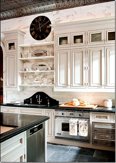 Beautiful French Country kitchen with a slate floor and wall featuring white marble subway tiles. Custom raised-panel cabinets and an old embossed tin ceiling complete the look of understated elegance. (via Home )