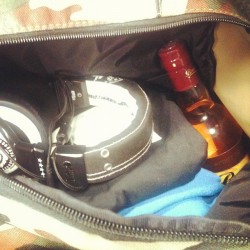 Bag contents: headphones, clothes, wedding party invite, rum (Taken with instagram)