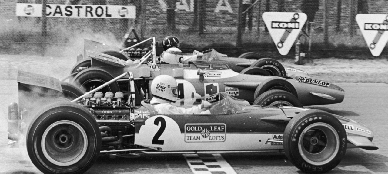 "asaucerfulofwheels:  Rindt/Lotus 49B/Stewart/Matra MS80/Hill/Lotus 49B/Zandvoort/1969 ""The side of Rindt's helmet bears the legend 'This $pace to let' which was put there by his manager, a little man called Bernie…"""
