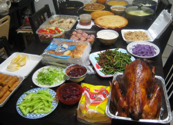 ohmyasian:  2046. Asian Thanksgiving. Chicken instead of turkey. Eggrolls, kimchi, or fried rice substituted for stuffing and mashed potatoes. Does your table look like this?