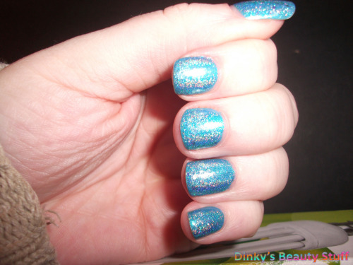 Glitter Gal Blue over Sally Hansen Flash and some glitter.