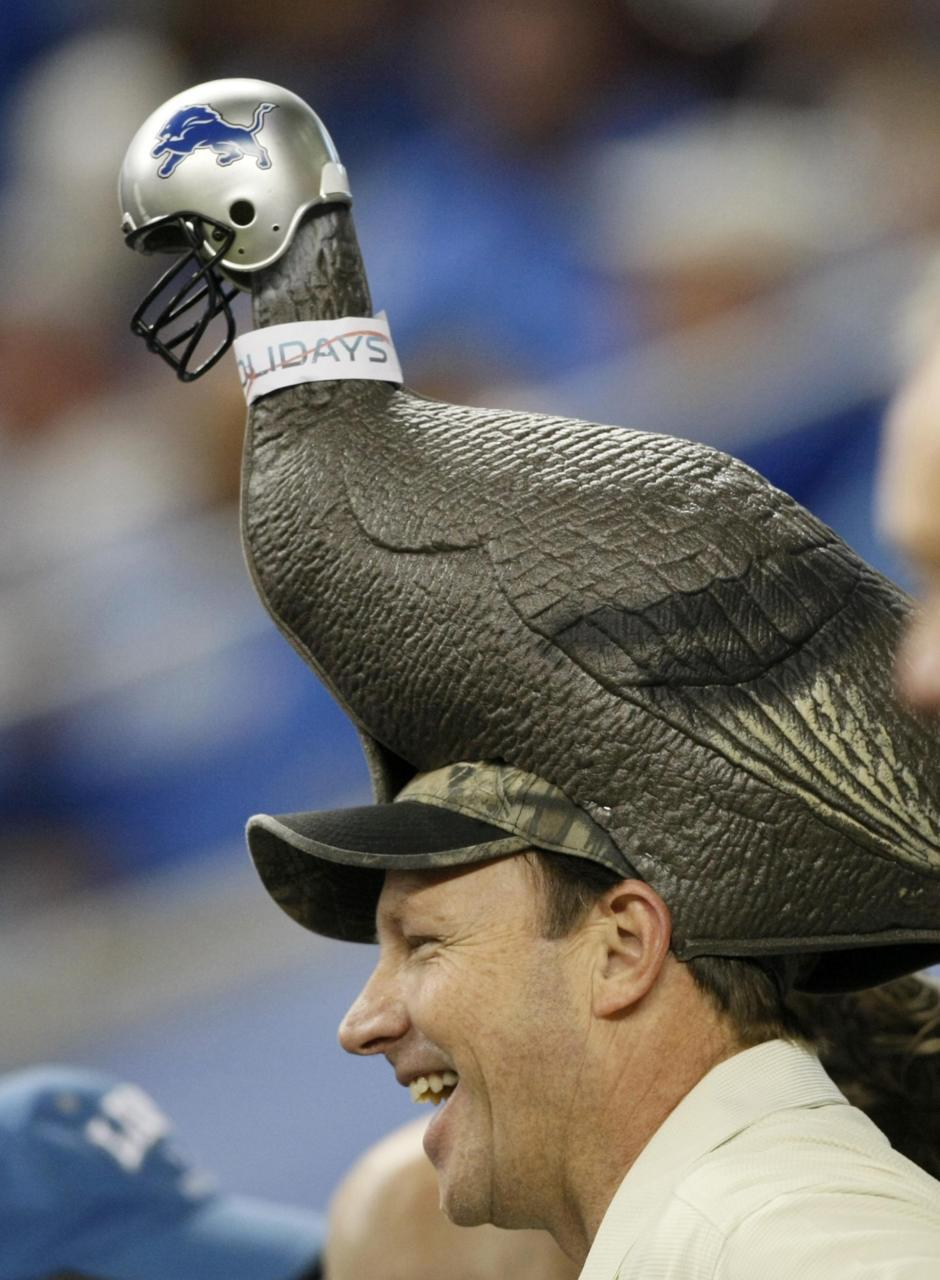 Don't be a turkeyA Detroit Lions fan, wearing a unique turkey decoy with team helmet, watches his team in the first half of their annual Thanksgiving NFL football game against the Green Bay Packers. Photo: REUTERS/Rebecca Cook