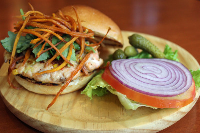"sandwiched:  ""Salmon Burger: North atlantic salmon cooked to perfection with sweet potato Matchsticks"""