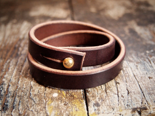 "#2. Dark brown double wrap bridle leather bracelet  A Hollows Leather classic in dark brown Wickett & Craig bridle leather with a brass press stud   closure.    Choose from two sizes, (S/M) for wrists up to 6.5"", or (L) for wrists up to 7.5"".  $20, normally $25.  Limited to 20 units at this price.  When they're gone, they're gone.  Shipping in the US is $5, international is $15. Email hollowsleather(at)gmail.com to purchase.  Any order of three items or more gets you a free patch."