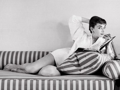 theniftyfifties:  Audrey Hepburn studies her script between takes on the set of 'Sabrina', 1953. Photo by Mark Shaw.