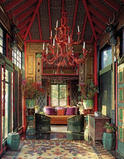 Colorful Boho living room with red accents… love the amazing chandelier (via Red / little blue deer)