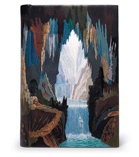 "The Lord of the Rings by J.R.R Tolkien. Leather Book Cover and Binding (1997) by Philip Smith. ""This is the third in a set of nine bindings of this title commissioned to represent a high point or crisis in the life of one of the nine characters comprising the Fellowship of the Ring. This is Legolas the elf being introduced by Gimli the dwarf to the glories of the glittering caves of Aglarond behind Helm's Deep. The book edges of the set all have paintings continuing the visual elements of the bindings and growing out from the sewn endbands."" Simply stunning work!"