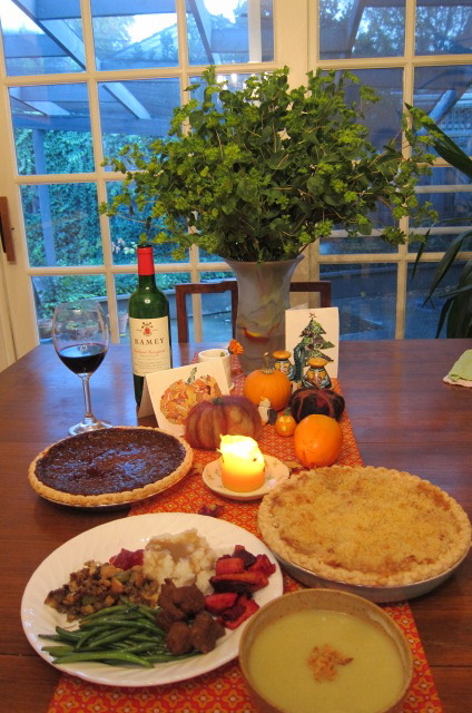 eat all the foods! vegansaurus:  Happy Thanksgiving from the Monica of the Berkeley Organization for Animal Advocacy! She sent us this photo of their annual Thanksliving feast (sorry! I can't read!) her family's Thanksgiving feast, where they ate roasted root vegetables with sage butter, mashed potatoes, mushroom gravy, stuffing, Gardein, cranberry sauce, green beans with almonds, potato leek soup, pumpkin pie, apple and persimmon crumble, and apple spice cider. What a spread!
