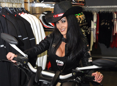 Not sure if this girl rides, but I want that Ducati accented cowboy hat! Zing! Photo from SoCal Ducati's fashion night.