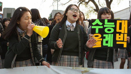 "[SOUTH KOREA] Most South Korean students consider their final year in high school ""the year of hell."" It is when all students are put to the ultimate test. About 700,000 test applicants sat down in classrooms across the country Thursday to take their college entrance exams — also known as the College Scholastic Ability Test (CSAT). The stock markets opened an hour late, buses and subway services were increased and police cars offered rides for students, all to ensure they made it on time. (via South Korean students' 'year of hell' culminates with exams day - CNN.com)"