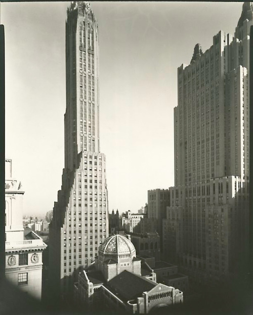 "Park Avenue & 51st Street, NYC, New York by Berenice Abbott Great 1936 photo capturing, among other things, the ""other"" G.E. Building. From ""Changing New York: Photographs by Berenice Abbott, 1935-1938,"" available through the NY Public Library Digital Gallery. (See also the book of the same name.) Detail of this photo:  St. Bartholomew's, Waldorf Astoria, General Electric Building, Park Avenue and 51st Street, Manhattan. (April 02, 1936)"