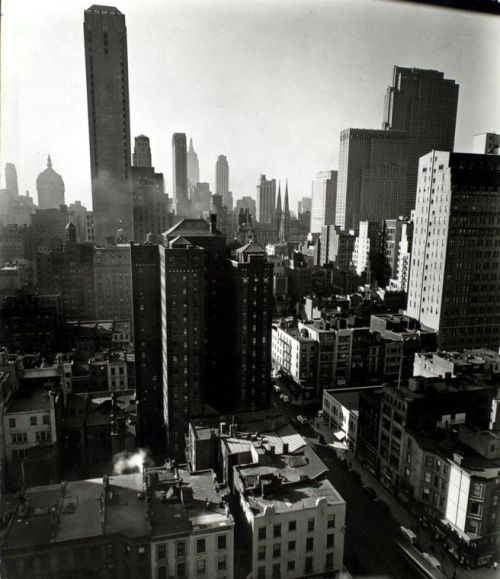 "View South from W. 57th Street, NYC, New York by Berenice Abbott I love the contrast of lights and darks in this. From ""Changing New York: Photographs by Berenice Abbott, 1935-1938,"" available through the NY Public Library Digital Gallery. (See also the book of the same name.) Detail of this photo:  General view looking south from Bignou Gallery, 18th floor, 32 East 57th Street, Manhattan. (January 27, 1937)"