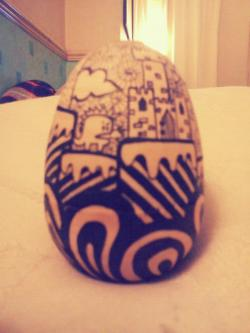 One side of my egg doodle. Other side has mountains and a sun.