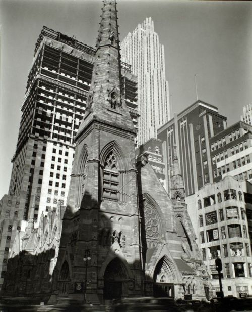 "St. Nicholas + Rockefeller Center, NYC, New York by Berenice Abbott Rockefeller Center under construction, 1936. From ""Changing New York: Photographs by Berenice Abbott, 1935-1938,"" available through the NY Public Library Digital Gallery. (See also the book of the same name.) Detail of this photo:  Rockefeller Center: Collegiate Church of St. Nicholas in foreground, Fifth Avenue and 48th Street, Manhattan. 					 					 	 					 	 					 					 					 						(December  08, 1936)"