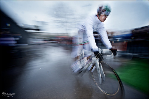 "2010 Kuurne-Brussels-Kuurne: Photo captions are often classified as ""bland and/or lame words lacking in even the simplest of poetry inherent in any language"" by artsy-fartsy me; alas, my ready-to-judge attitude to editorial wording faltered up against these words provided by Kristof Ramon: ""Italian Champion Pozato [sic] still manages to look elegant (in white!) in this soon to be apocalyptic race."" (Credit: Kristof Ramon via Flickr)"