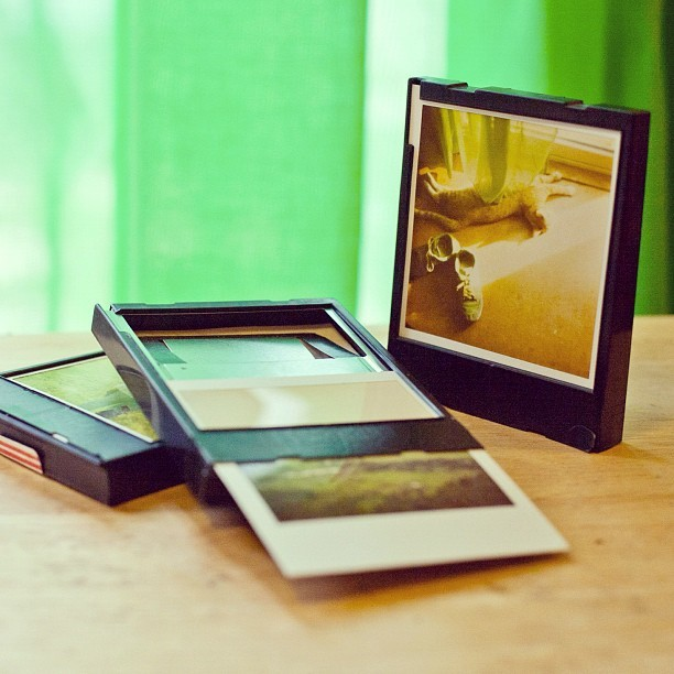 spotted via Photojojo on Instagram ░  Quick DIY tip: You can use old Polaroid cartridges as stand-up Polaroid frames! Just slip a developed shot back in the cartridge! Push down the metal piece & slide the print in through the bottom.