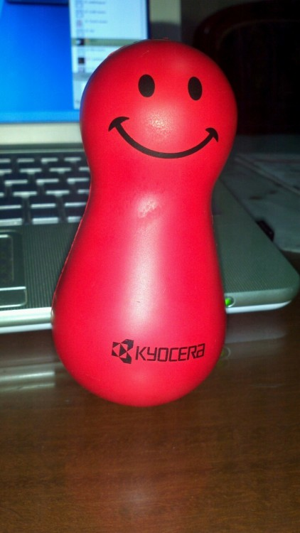 "Kyocera giveaway… a red rubber toy that keeps on standing! According to Doraemon it is called a ""buderama"" (don't know the spelling)… anybody knows?"
