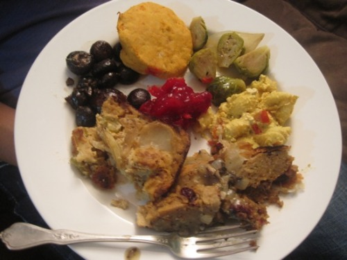 "Happy Thanksgiving from Aimee! Her plate consists of, ""clockwise from top: Tal Ronnen's sweet potato biscuits, glazed onions and brussels sprouts from Vegan Holiday Kitchen, Mac Daddy from Veganomicon, Field Roast Hazelnut Cranberry Roast En Croute with savory mushroom gravy, scalloped potatoes with tempeh bacon, rosemary roasted mushrooms from Vegan Holiday Kitchen, and holiday cranberry sauce from Veganomicon."