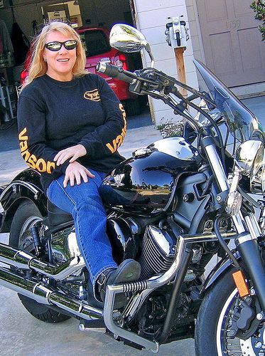 Shirley Duglin Kennedy with her 2005 Yamaha V-Star 1100 Midnight Custom, author of the Savvy Guide to Motorcycles. She's got a great view for women who ride.  Men come and go. Bikes are loyal.