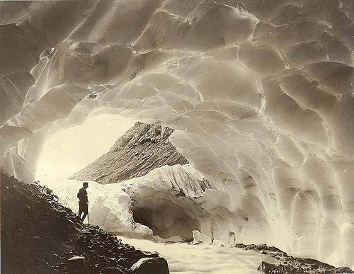 Mountaineer in one of the ice caves of Paradise Glacier, Mount Rainier National Park, Washington, ca. 1925.