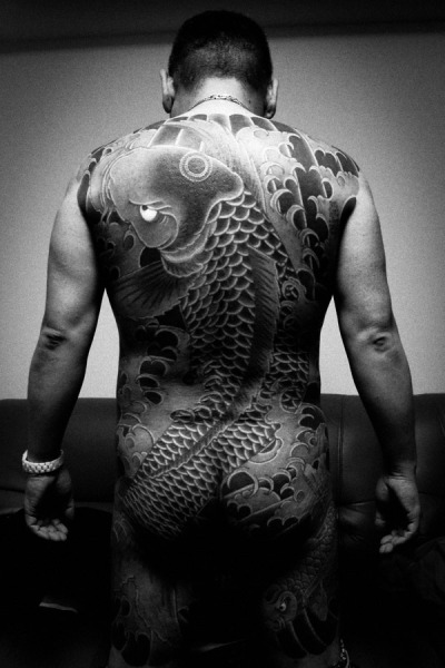 Photographer, Anton Kusters, photo of a Yakuza clan member's ink.