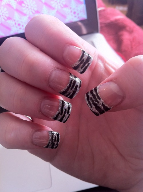 Had nails done at the salon, silver glitter tips. Zebra stripes dont by myself using Models Own Nail Pen.