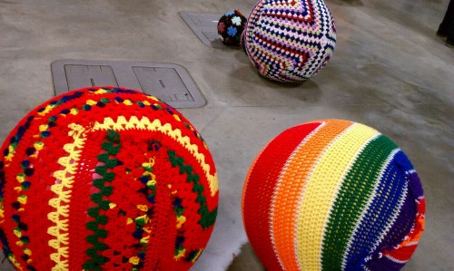 Saw another knitta please installation, this one was round balls at the renegade craft fair.