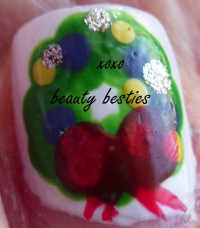 Easy to do Christmas wreath nail art! http://beautybesties.wordpress.com/2011/11/27/diy-christmas-wreath-nail-art/