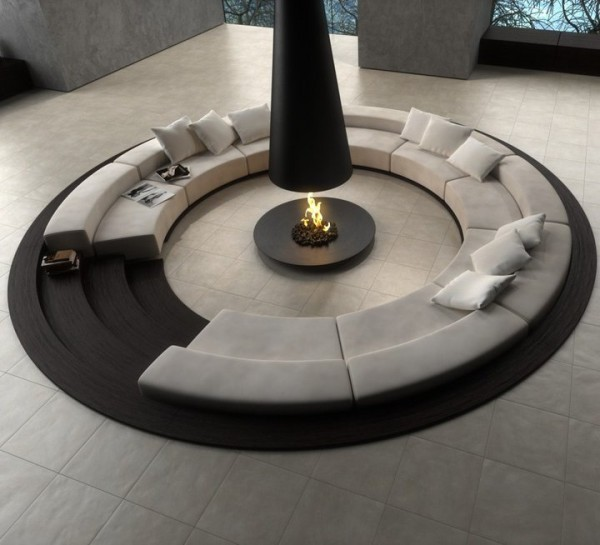 Sunken sofa with fireplace. Not sure who makes it, but it looks like a nice thing.