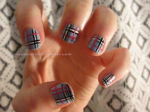 Blue plaid.  Here is a blue plaid design with pink accents.  It kind of looks like a scarf I own.  The flash blew out the colors so I took this with no flash. Polish used: Models Own Beth's Blue & Inglot 34