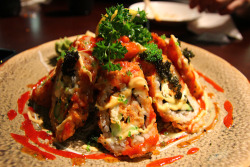 Sushiholic's Volcano Roll - Asparagus, Spicy tuna, cream cheese, avocado and cucumber roll all DEEP FRIED… and a mountain of spicy tuna sashimi inside. Just like a volcano. Makes sense AND it's delicious.