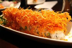Sushiholic's Awesome Roll… covered in yam fries.