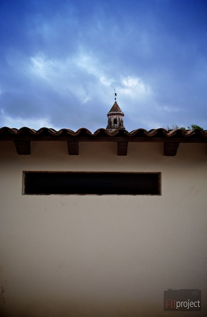 View of the Templo de la Compañía bell tower from a rooftop.