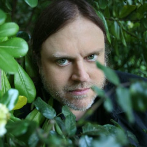 MATTHEW SWEET HOPES YOU LIKE LONG WALKS IN THE WOODS AND THAT YOU AREN'T SCARED OF THE KNIFE HE IS HOLDING.