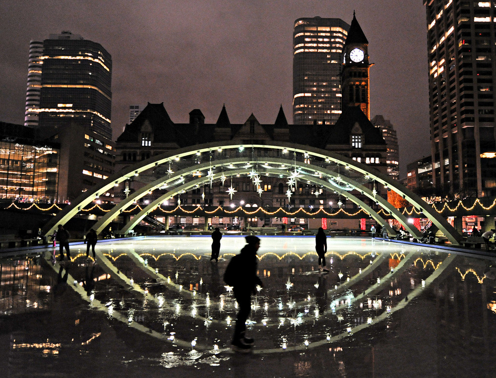 Skaters enjoy the mild weather at Toronto's Nathan Phillips Square, Sunday evening, November 27, 2011 as the city continues to experience temperatures above seasonal averages. (Photo: Aaron Lynett/National Post)