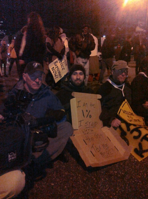 "westandwiththe99percent:  ""I am the 1%. I stand with the 99%. Tax me more!"" Two dozen of us — from the 1% and from the 99% — spent a night in jail for locking arms across Philadelphia's Market Street Bridge, which urgently needs repairs the city can't afford. Good jobs, better city — just need to tax those of us who own more than we need thanks to the labor of working people. http://blogs.philadelphiaweekly.com/phillynow/2011/11/18/hundreds-march-for-infrastructure-jobs-rally-on-market-street-bridge-24-arrested/"