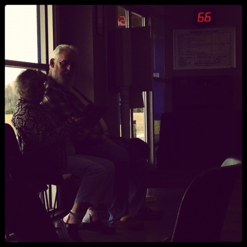 She Reads to Him.  At the DMV an older lady reads aloud to her husband. It's both terribly cute and horribly annoying.