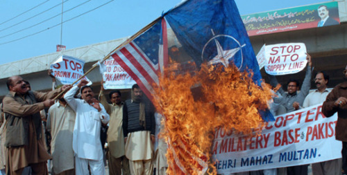 "Protesters burn a US flag during a protest in Multan on November 27, 2011 — Photo by AFP Pakistanis demand end to US alliance  Members of civil society, lawyers, traders and students organised the  rallies, still relatively small, in major cities of the country of 167  million people, where opposition to the US alliance is rampant. ""The government should cut Nato supplies permanently, take back military  bases from the US and plead that this cases violates the borders in the  UN Security Council""  >continue<  Another Hot Flash  